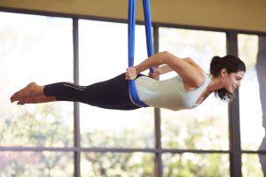 female-aerial-hammock-yoga-class-canyon-ranch-wellness-resort